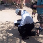 Prayerfully bowing before the Holy One of Israel Chris is looking in his Bible for the prophetic Word he had chosen.