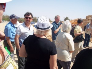 Alan explains in English, next to him his interpreter in Hebrew, while people go about taking pictures and marvel at those stones bearing witness of days long past