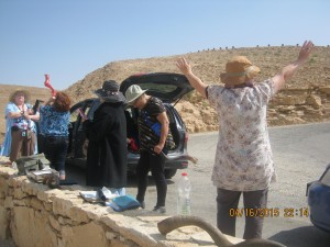 While she is sowing one of G-d's many promises regarding the Negev, the others are praying in agreement.