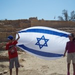 "What a triumphant image in front of these ancient stones – a new generation lifting up Israel's banner referred to as ""nes / miracle"" in Isaiah 49:22, and 62:19"