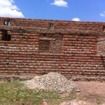 Just the bricks, no smoothing the walls with mortar; no window frames, no roof