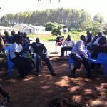 Bishops, Pastors, and women from Mt. Elgon still waiting for the busses. In background Pan Paper houses